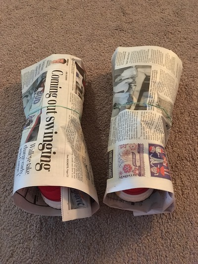 Athletic shoes wrapped with newspaper