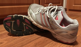 Old, worn out athletic shoes