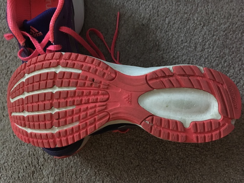 Athletic shoe features include the outsole of the shoe.
